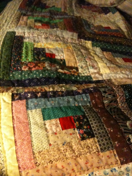 The dark and light contrasting pattern on my mom's handmade Log Cabin Quilt are meant to be an analogy to the darker, harsher, wintry days of life, and the brighter, joyful, summery days of life.